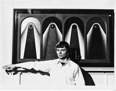 Artist John Willenbecher at an exhibition of his work