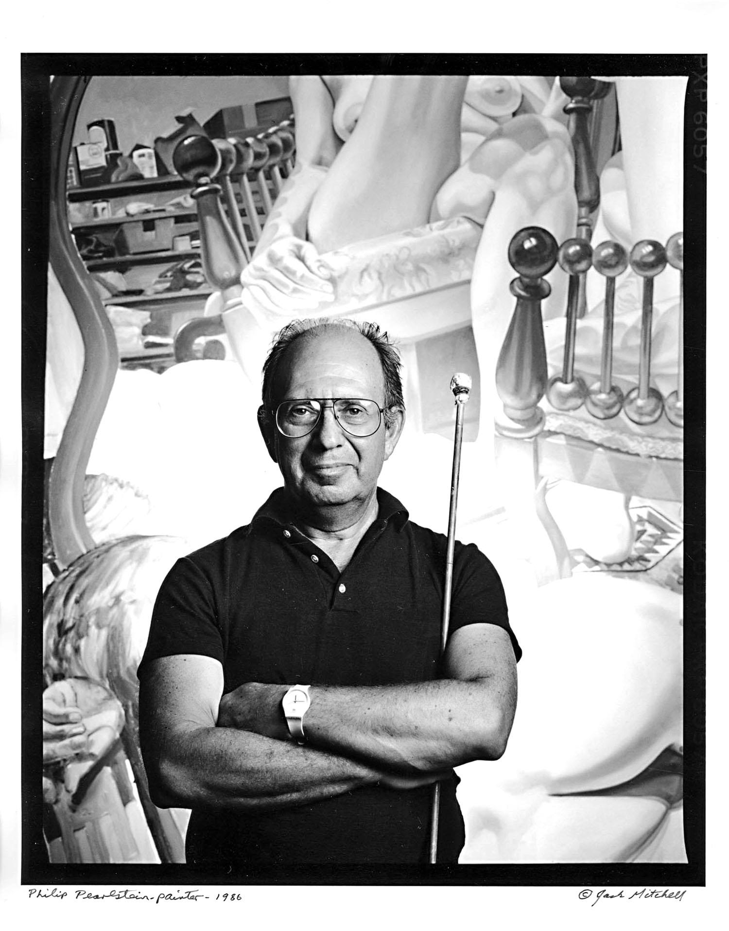 Artist Philip Pearlstein in his studio with his work, signed by Jack Mitchell