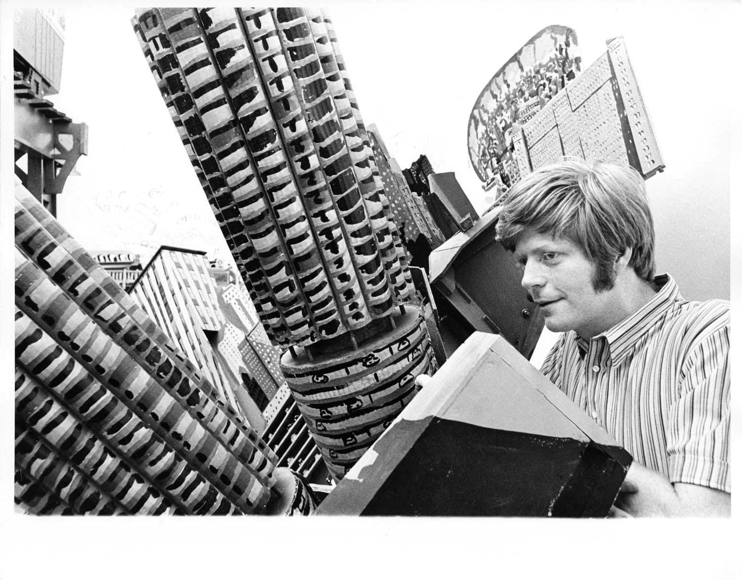 Artist Red Grooms with his art installation 'Chicago', signed by Jack Mitchell