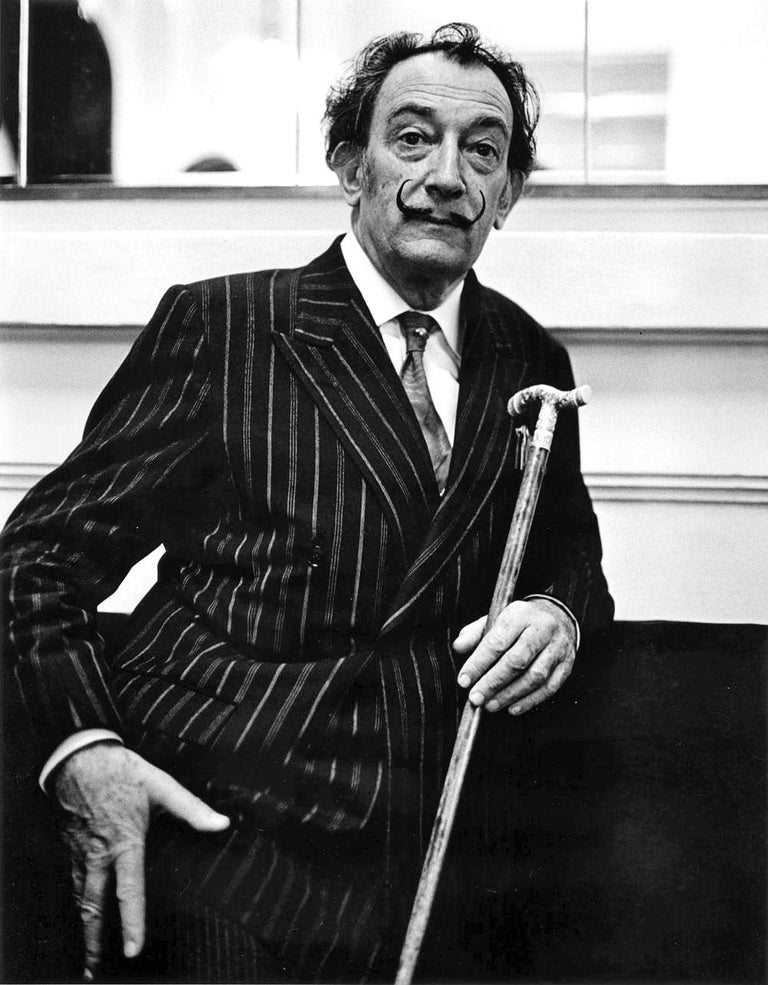 """11 x 14"""" vintage silver gelatin photograph of artist Salvador Dali photographed in the lobby of the Ritz Hotel in Barcelona, Spain in May 1966. Signed by Jack Mitchell on the print verso.  Comes directly from the Jack Mitchell Archives with a"""