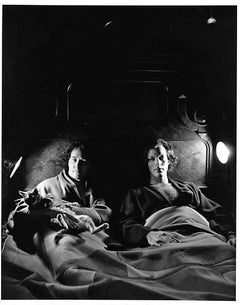 Artists (and partners) Robert Indiana and William Katz in bed with their pet cat