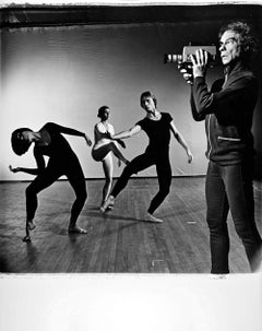 Merce Cunningham with dancers and video camera performing 'TV Rerun'