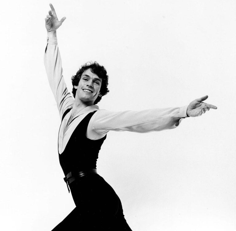 Olympic Gold Medal winning British figure skater John Curry, signed by Mitchell - Photograph by Jack Mitchell