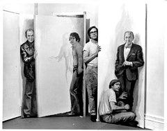 Painter Willard Midgette posing with his paintings