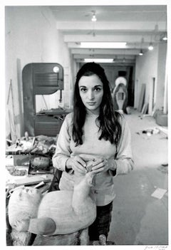 Sculptor Marisol (Maria Sol Escobar) in her studio, signed by Jack Mitchell