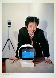 Video artist Nam June Paik photographed with his latest multimedia work.
