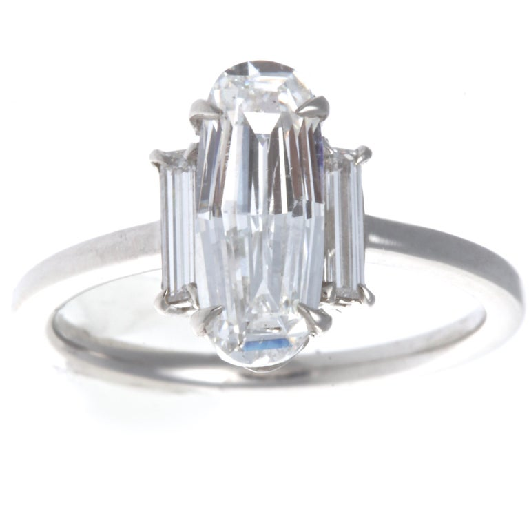 A unique old step cut that brings out the life and sparkle of the diamond. GIA 1.59 carat old step cut, F color SI1 clarity diamond platinum engagement ring. Accented by 2 two baguette cut diamonds weighing approximately  0.30 carats, E-F VVS. Ring