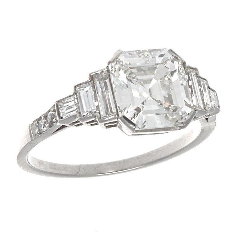 From Jack Weir & Sons, this GIA certified 2.02 is the crowning glory of this Art Deco styled platinum engagement ring. Cut to display it's perfection, this emerald cut diamond has a high clarity grading of VVS1 and is also a very white H color. With