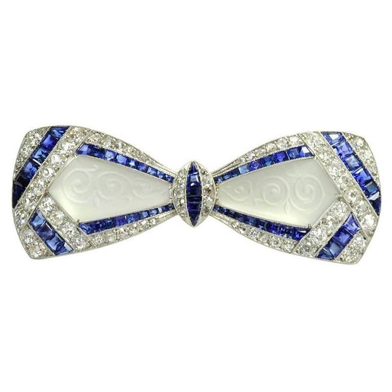Women's or Men's Jackie Kennedy's Art Deco Diamond Sapphire Frosted Crystal Bow Brooch For Sale
