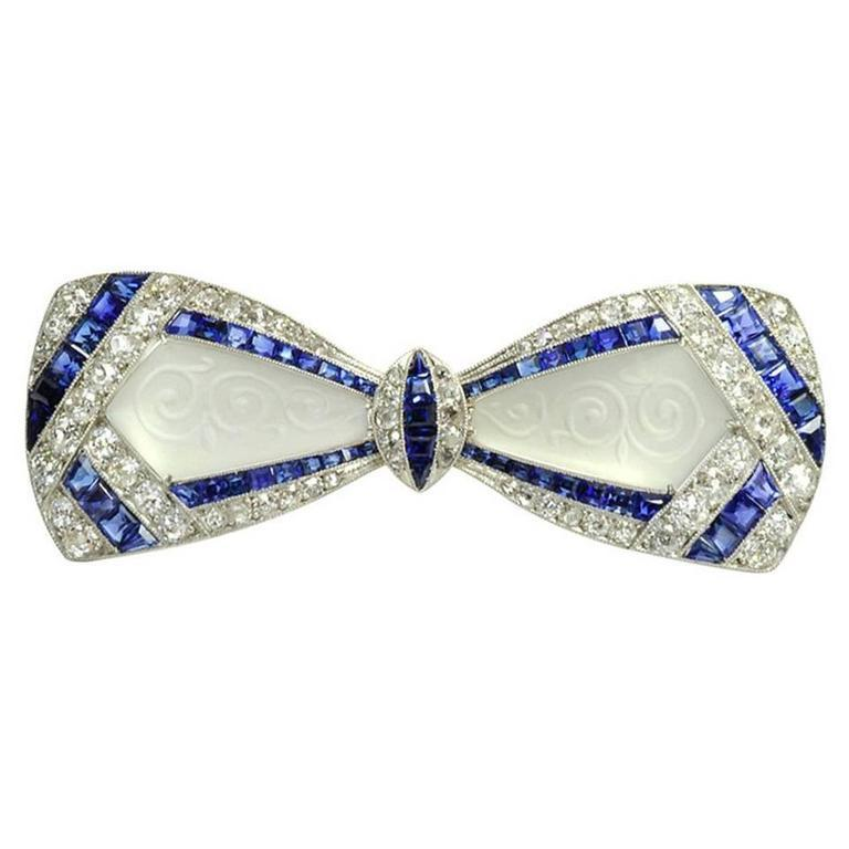 Jackie Kennedy's Art Deco Diamond Sapphire Frosted Crystal Bow Brooch For Sale 1