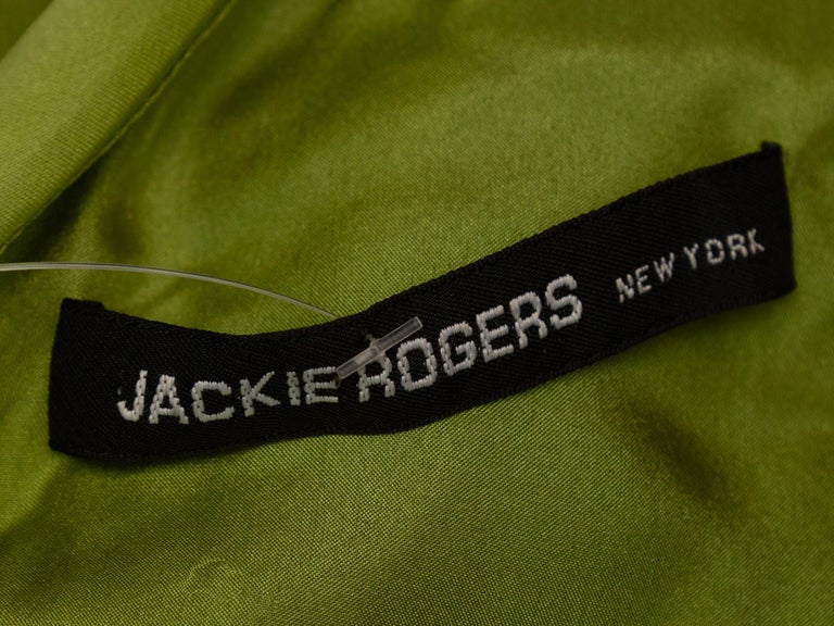 Product details: Lime green one shoulder mini dress by Jackie Rogers. Draped detailing at side bust. 30