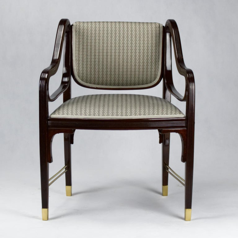 Design created by Otto Wagner (1841-1918) and manufactured by Jacob & Josef Kohn Manufactory. Beechwood / mahogany stained / brass / seat covered with new fabric and horizontal brass struttings attached to feet. Catalogue