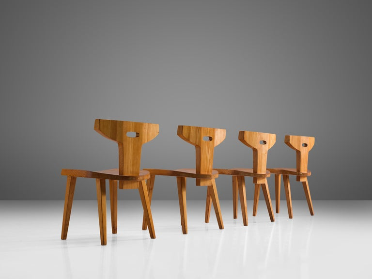 Jacob Kielland-Brandt, set of four dining chairs, solid pine, Denmark, 1960s  This remarkable set holds a strong expression. The backrests have an open look and organically support and optimize the seating comfort. The wood structure has a beautiful