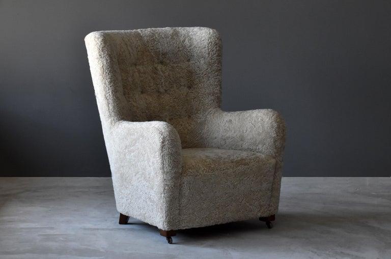 Scandinavian Modern Jacob Kjær, Attribution High-Back Lounge Chair, Sheepskin, Denmark, 1940s