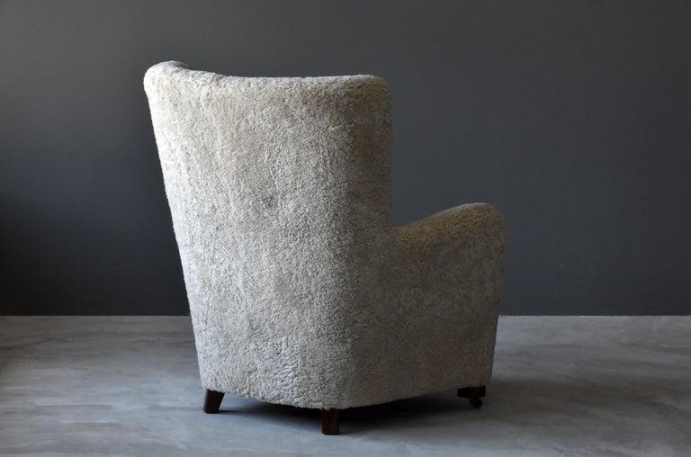 Danish Jacob Kjær, Attribution High-Back Lounge Chair, Sheepskin, Denmark, 1940s