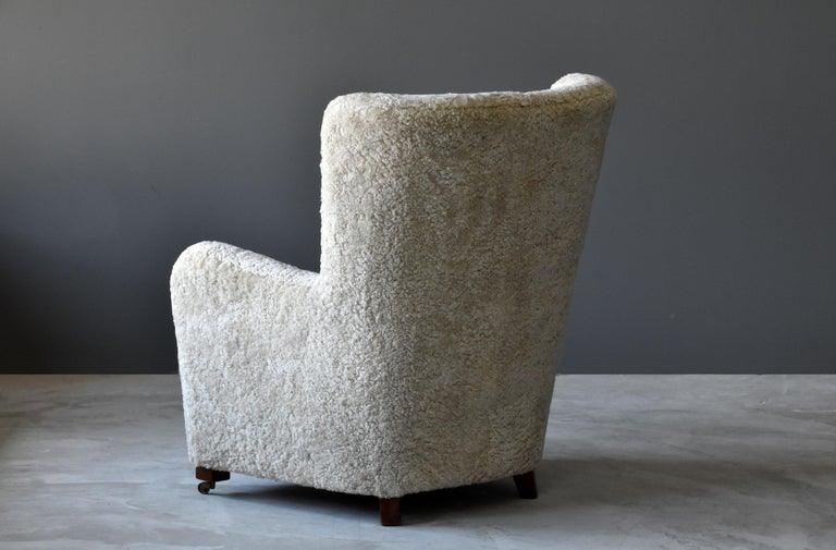 Jacob Kjær, Attribution High-Back Lounge Chair, Sheepskin, Denmark, 1940s In Good Condition In West Palm Beach, FL