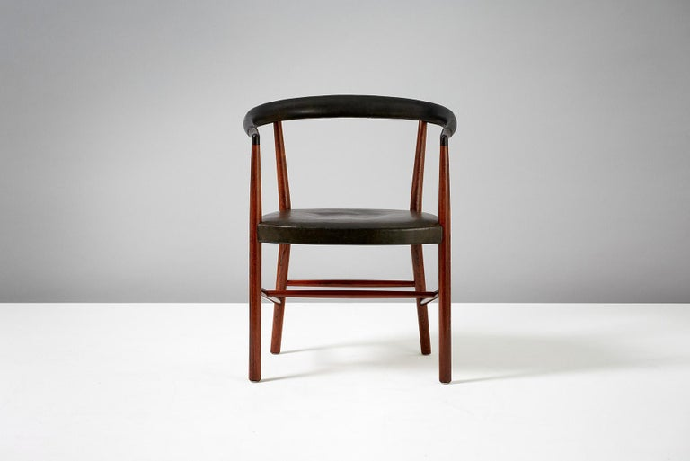 Jacob Kjaer   UN Chair, 1949  Model B-37 armchair designed in 1949 for the UN headquarters in New York. Produced in Brazilian rosewood with seat and back upholstered with original black patinated leather. This example made approximately