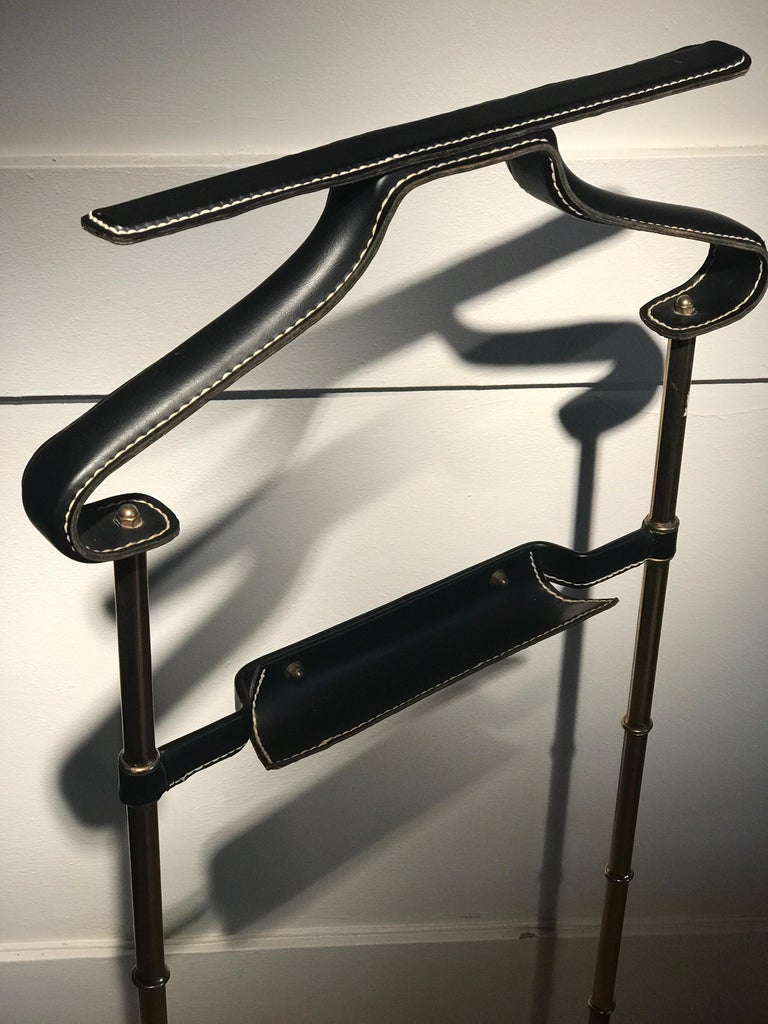 Jacques Adnet stiched faux leather and brass details and feet. Good condition.