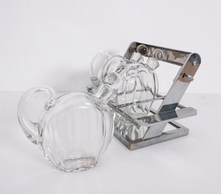 Plated Jacques Adnet Attributed Tantulus Containing Three Baccarat Carafes For Sale