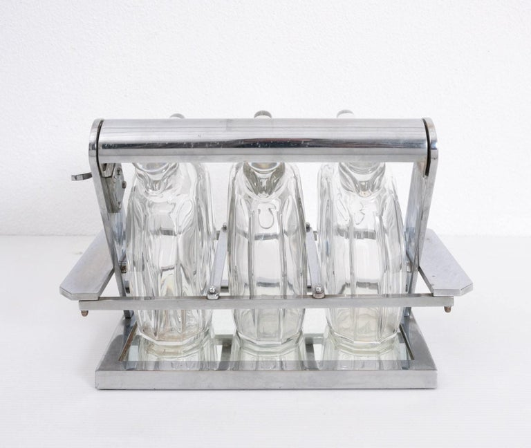 Jacques Adnet Attributed Tantulus Containing Three Baccarat Carafes In Fair Condition For Sale In Fingest, Oxfordshire