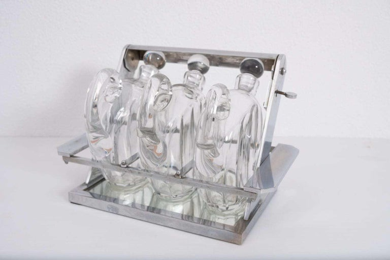 Mid-20th Century Jacques Adnet Attributed Tantulus Containing Three Baccarat Carafes For Sale
