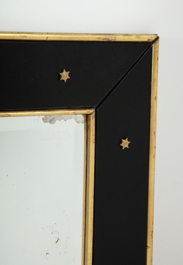 Mid-Century Modern Jacques Adnet Black Glass and Gold Leaf Wall Mirror with Star Detail, circa 1940 For Sale
