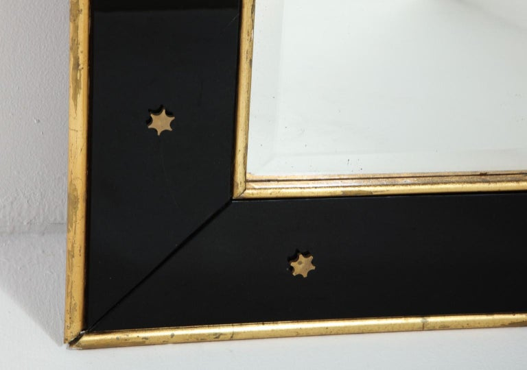 French Jacques Adnet Black Glass and Gold Leaf Wall Mirror with Star Detail, circa 1940 For Sale