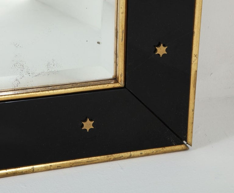Jacques Adnet Black Glass and Gold Leaf Wall Mirror with Star Detail, circa 1940 In Good Condition For Sale In Chicago, IL