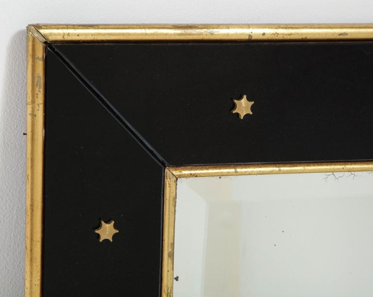 Mid-20th Century Jacques Adnet Black Glass and Gold Leaf Wall Mirror with Star Detail, circa 1940 For Sale