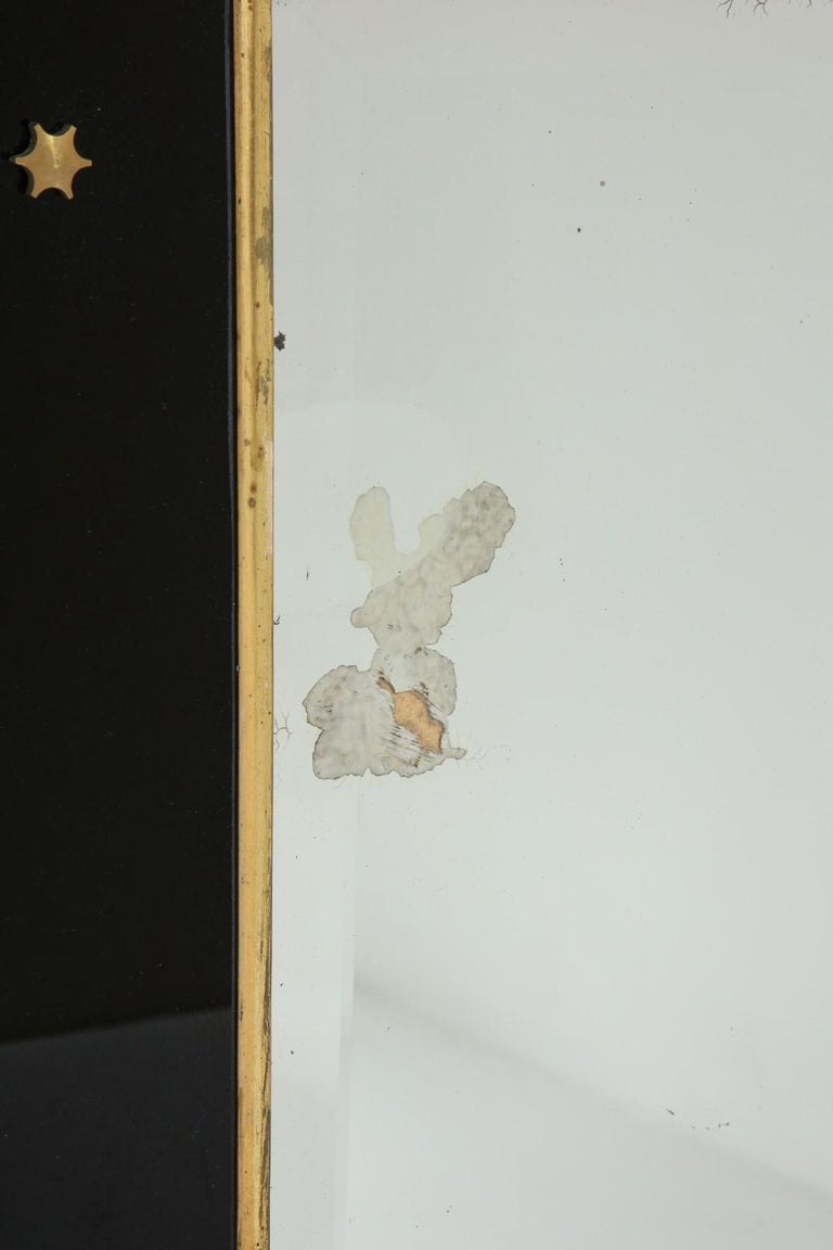 Jacques Adnet Black Glass and Gold Leaf Wall Mirror with Star Detail, circa 1940 For Sale 1