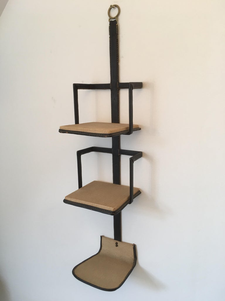 Very rare original stitched leather bookcase designed by Jacques Adnet in France in 1950s.
