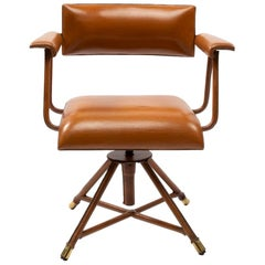 Jacques Adnet, Cognac Saddle Stitched Leather Swivel Chair