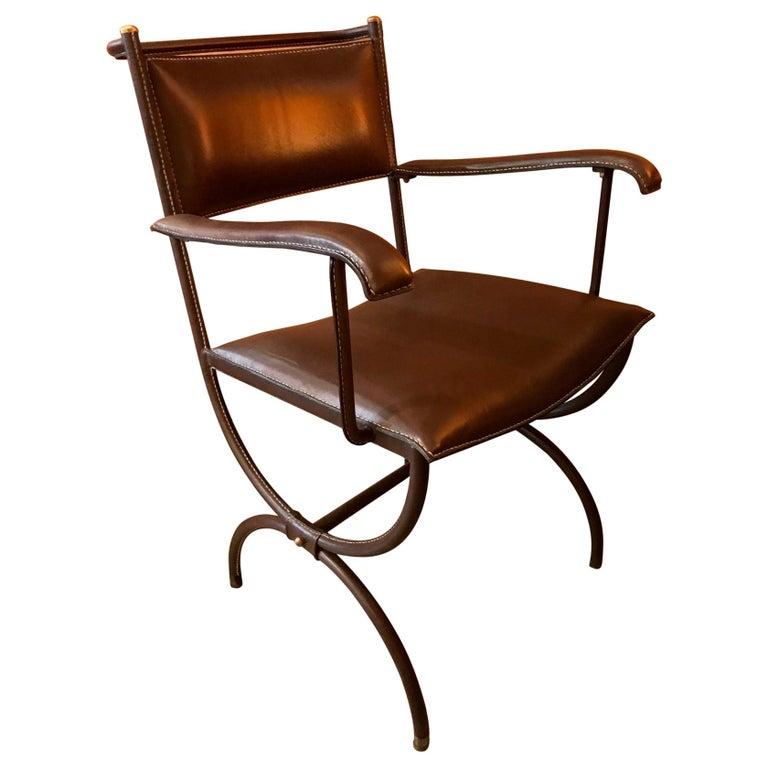 Jacques Adnet desk armchair, 1950s, offered by Galerie Edouard de la Marque