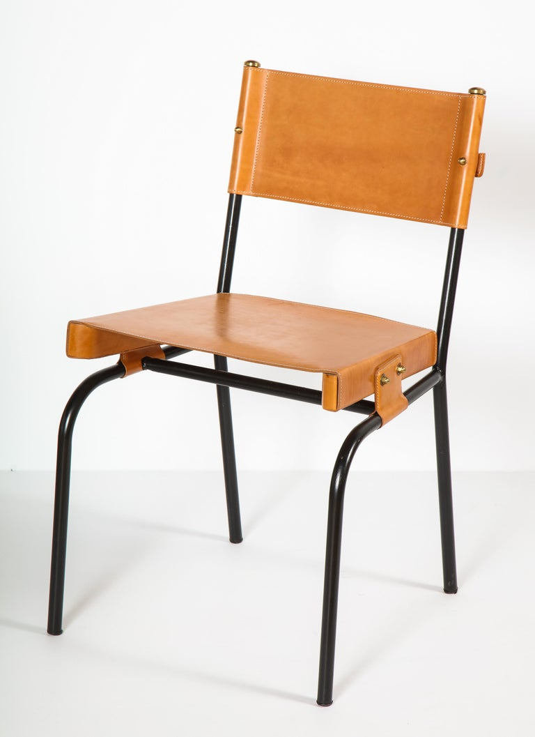Exceptional set of Jacques Adnet dining chair with period correct leather restoration. Sold as a set or pair only.