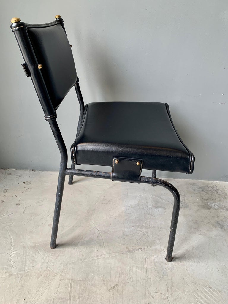 Jacques Adnet Leather Chair with Matching Footstool In Good Condition For Sale In Los Angeles, CA