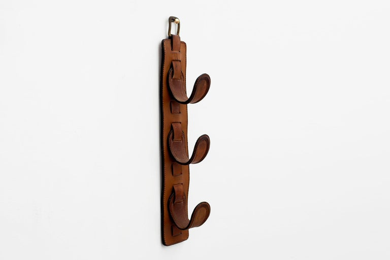 Beautiful equestrian saddle leather coat rack by Jacques Adnet