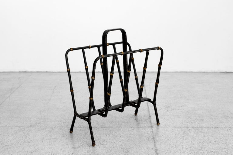 Large handstitched black leather magazine rack by Jacques Adnet. Unique leather and brass ring bamboo detailing. Beautiful original leather with patina and age.