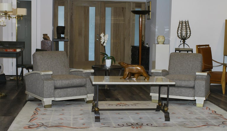 Jacques Adnet model of pair of large comfortable armchairs in off white/beige lacquered mahogany upholstered in gray/green textured fabric. Sockets in patinated solid brass. Jacques Adnet designed this model in 1945-1950. Our pair has been