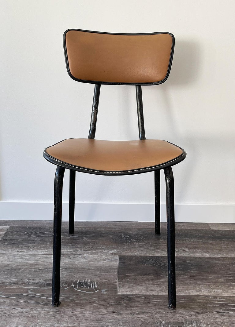 Jacques Adnet ( 1901-1984) Original chair in black lacquered metal and faux-leather camel color upholstery and vinyl piping. Original condition.
