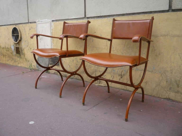 Jacques Adnet pair of hand stitched arm chairs in vintage condition.
