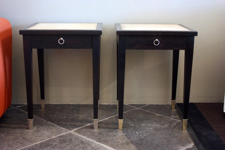 Jacques Adnet, (1900-1984) Very rare pair of side tables in black lacquered wood, parchment, and silver plated bronze sabots. Each has one drawer with an oxidized brass ring handle. France, 1940. Drawer is in beach wood and ash. Structure is in a