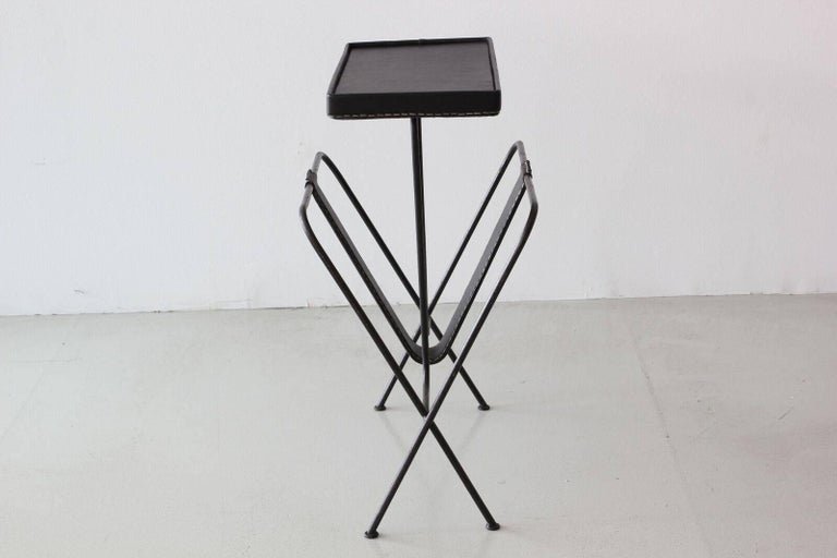Jacques Adnet side table with magazine holder and newly done signature black leather with contrast stitching.