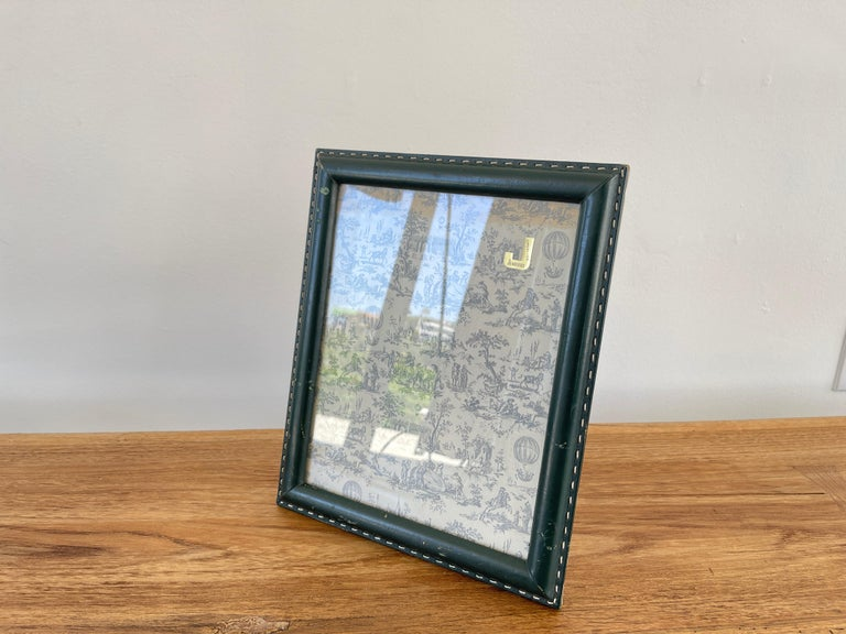 Jacques Adnet style green leather with signature contrast stitching - photo frame.  Matching smaller frame and desk set available in same hunter green.
