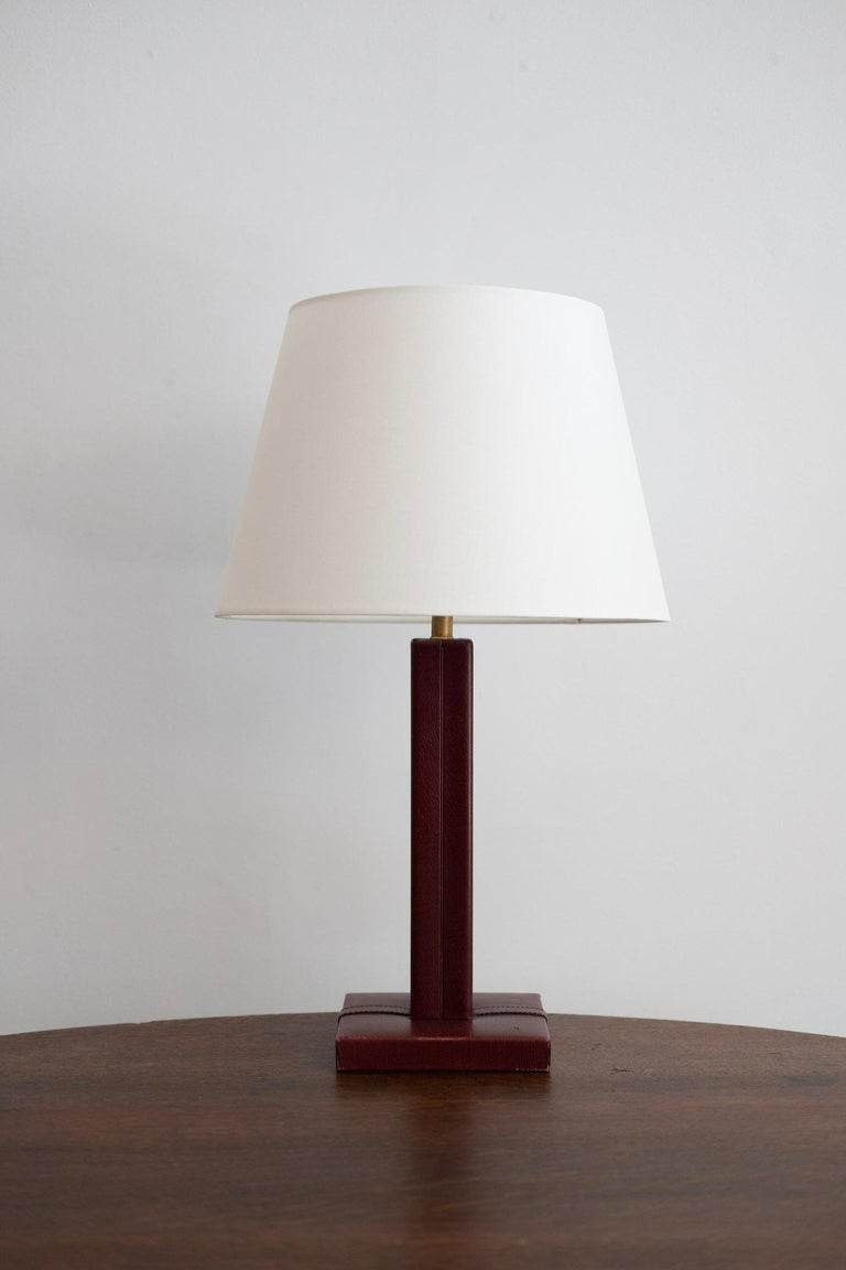 Jacques Adnet style table lamp with dark brown leather with contrast stitching,  new shade and newly rewired.