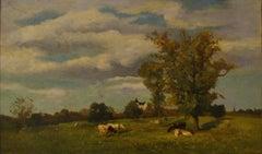 Vaches dans un paysage de printemps près d'un chateau
