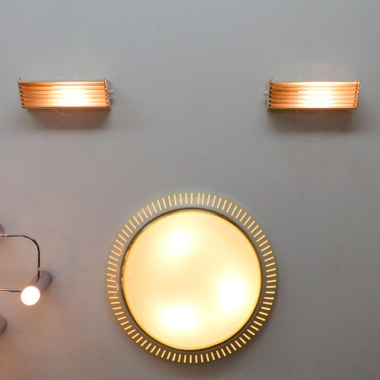 Jacques Biny for Luminalite Edition Model '212' Wall Lights For Sale 1