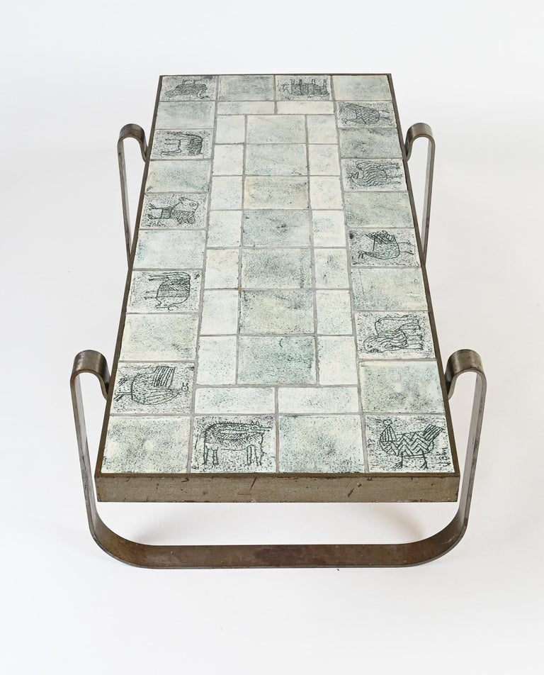 Rare modernist midcentury steel-framed low table composed of ceramic tiles of animals by Jacques Blin. Jacques Blin, born in France in 1920 originally trained in engineering diploma. In 1954, choosing to follow his passion, he founded his own
