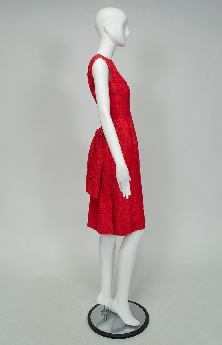 Though his work has only recently begun to be appreciated, Lebanese designer Jacques Cassia was a familiar face among the haute monde in the 1960s and 70s. With its gentle bustle and backless silhouette, this cocktail dress is an extremely rare