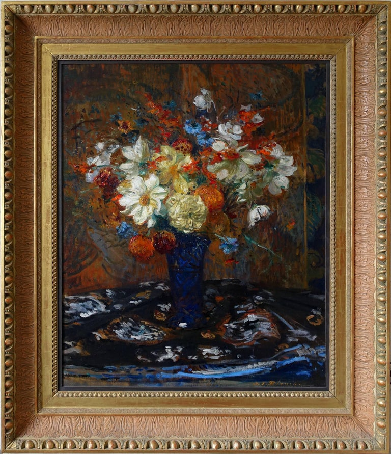 A beautiful floral oil painting by the French Impressionist artist Jaques-Emile Blanche. This stunning Impressionist painting, painted circa 1900 depicts a vast floral bouquet of white dahlias, blue cornflowers and orange crocosmia. The