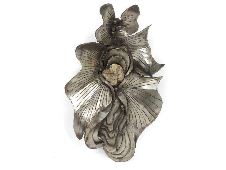 Jacques Lerebourg hand made abstract metal sculpture in welded and polished metal with inclusion of a natural quartz or crystal mineral specimen. part of a distinguished group of French 1970s artists and craftsmen which includes, Jacques Duval